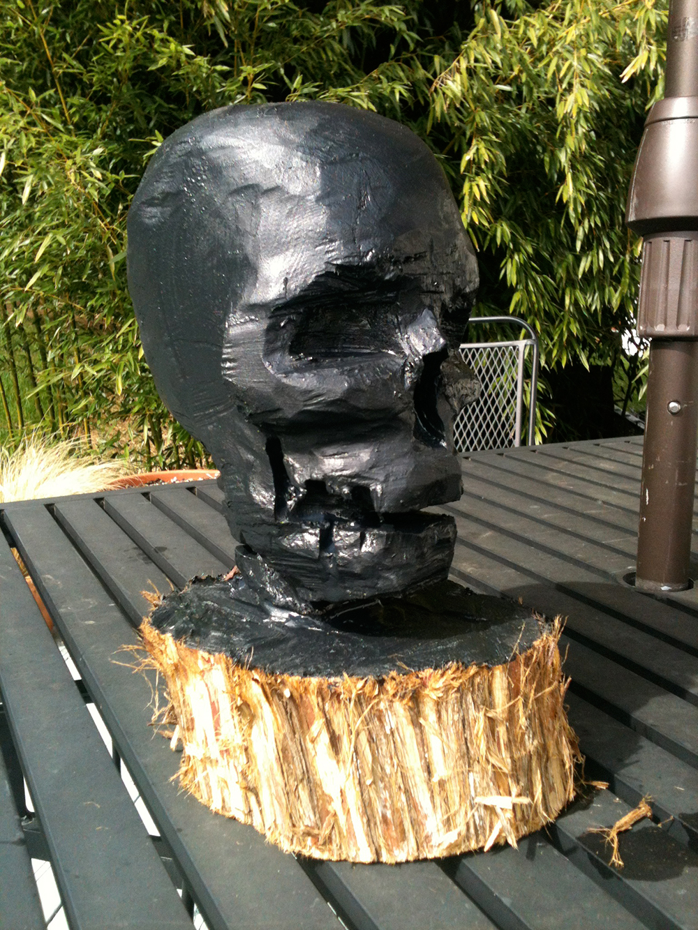 zdepski's chainsaw carving of a skull, painted black